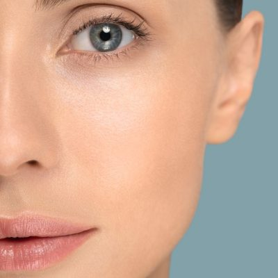 close-up-of-woman-face-with-perfect-fresh-clean-skin-without-make-up-and-wrinkles-looking-at-camera_t20_N0KByr